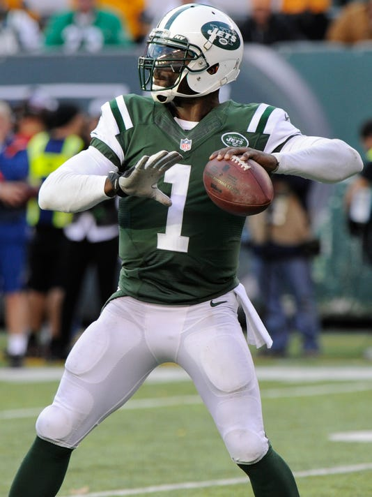 New York Jets quarterback Michael Vick (1) throws a pass during the second half of an NFL football game against the Pittsburgh Steelers on Sunday, Nov. 9, 2014, in East Rutherford, N.J. (AP Photo/Bill Kostroun)