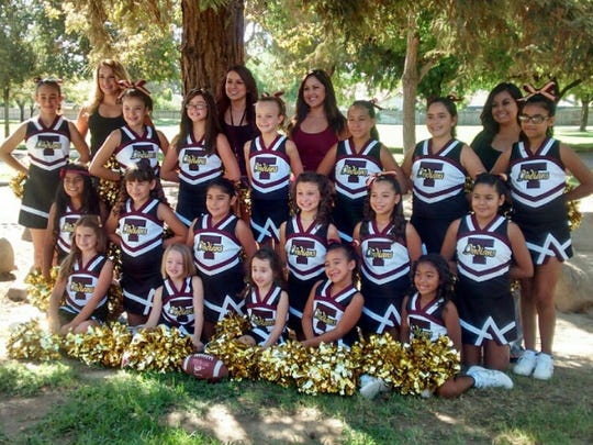 The cheerleading squad for the Tulare Indians youth football team. The cheer squad will perfroem at the Tulare County Fair.