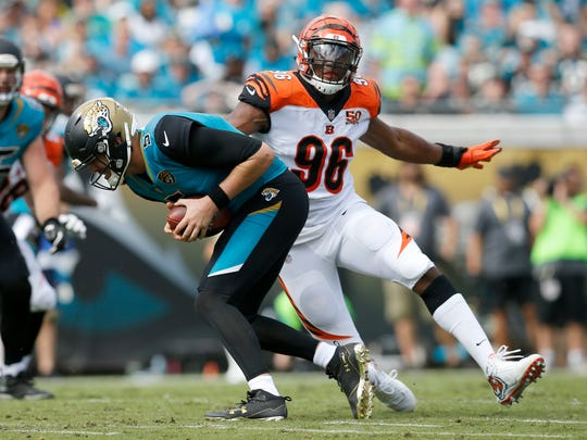 Jacksonville Jaguars quarterback Blake Bortles (5) is rushed out of the pocket by Cincinnati Bengals defensive end Carlos Dunlap (96) in the second quarter of the NFL Week 9 game between the Jacksonville Jaguars and the Cincinnati Bengals at EverBank Field in Jacksonville, Fla., on Sunday, Nov. 5, 2017. At halftime the Bengals trailed 10-7. Cincinnati Bengals wide receiver A.J. Green (18) and Jacksonville Jaguars cornerback Jalen Ramsey (20) were ejected for fighting.