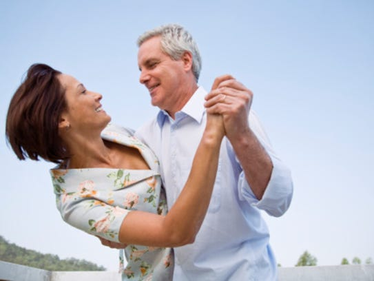 Smiling couple dancing, courtesy Getty Images