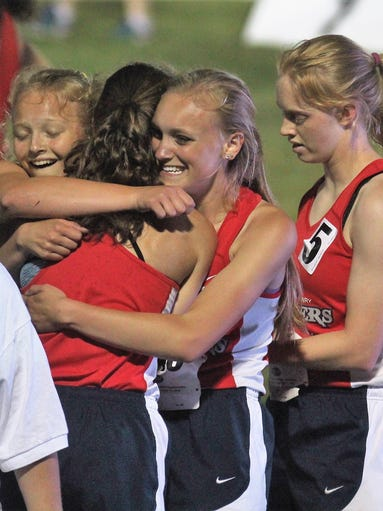St. Henry's 4x400 runners celebrate their win during