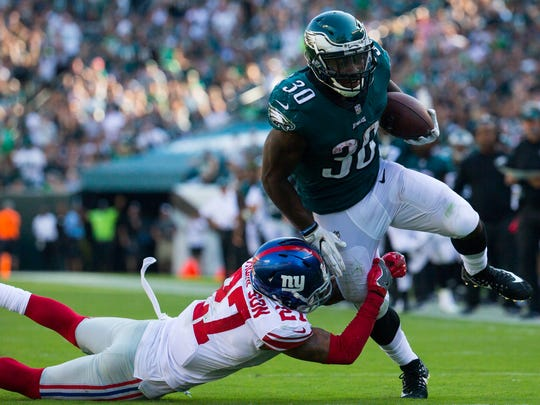 Eagles running back Corey Clement breaks the tackle of New York's Malcolm Jenkins to go on to score during their game Sunday at Lincoln Financial Field.