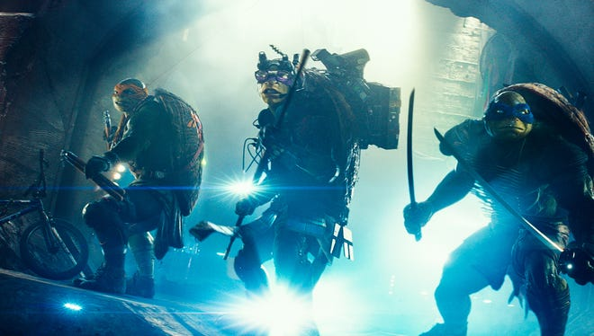"""The characters Michelangelo, from left, Donatello, and Leonardo appear in a scene from """"Teenage Mutant Ninja Turtles."""""""