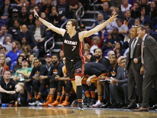 Miami Heat guard Goran Dragic reacts after making a