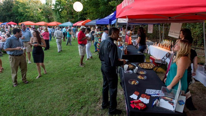 Locals take part in the food and spirits at the Zoobilation event at the Montgomery Zoo in 2016. This year's event was canceled because of the pandemic.