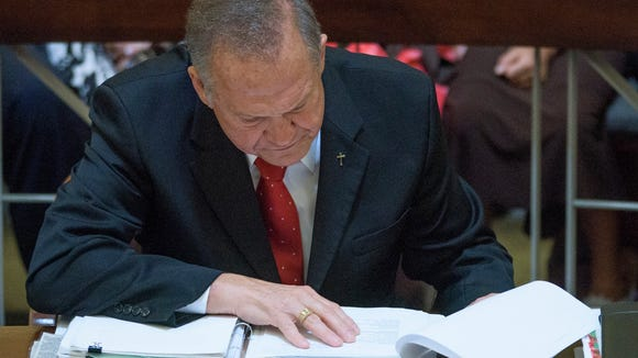 Embattled Alabama Chief Justice Roy Moore looks over evidence during his ethics trial at the Alabama Court of the Judiciary at the Alabama Judicial Building in Montgomery, Ala., on Wednesday September 28, 2016.