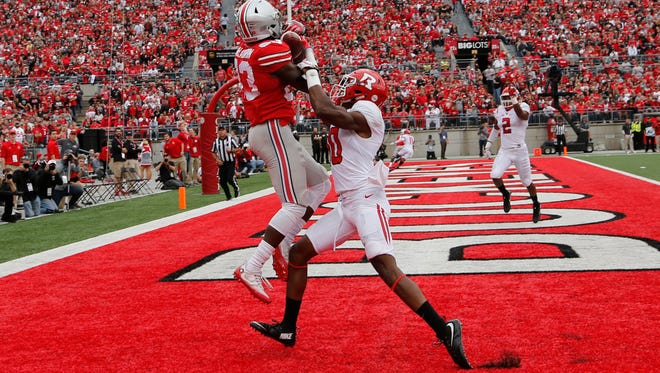 Ohio State wide receiver Terry McLaurin, left, grabs a touchdown pass over Rutgers defensive back Blessuan Austin during the first half.Saturday. (AP Photo/Jay LaPrete)