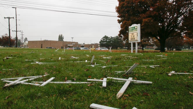 A display of crosses in the front lawn at Faith Bible Church in Delta Township was vandalized some time around Tuesday, Nov. 14, 2017. Signage at the display says each cross represents 44 abortions