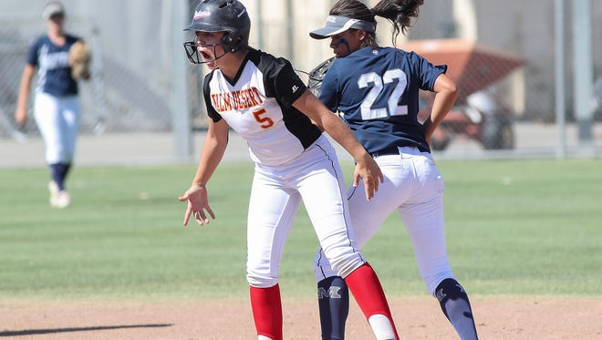 Palm Desert's Sydney Sprinkle yells after hitting a double to fire up her team during their game against Mayfair, May 17, 2018.