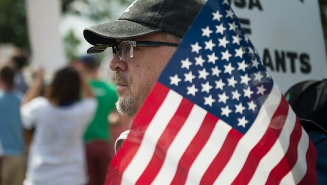 """Kevin Burton, of Gallatin, Tenn., waits for the start of a march against various immigration policies on Saturday, June 30, 2018, in Nashville, Tenn. Marchers traveled from Fannie Mae Dees Park to near Belmont University chanting such sayings as """"ICE Free Tennessee."""""""