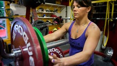 Muscle mom squat-lifts three times her body weight to win world championships