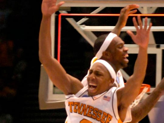 Tennessee's Tyler Smith and JaJuan Smith celebrate after the win over Butler at the Birmingham Jefferson Convention Center in Birmingham, Alabama during second round play in the NCAA Tournament on Sunday. Tennessee defeated Butler 76-71 and will advance to the Sweet Sixteen in Charlotte, NC next week.