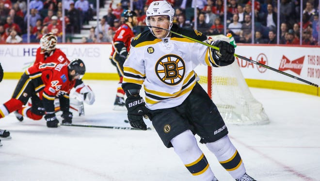 Boston Bruins left wing Brad Marchand celebrates a goal against the Calgary Flames.