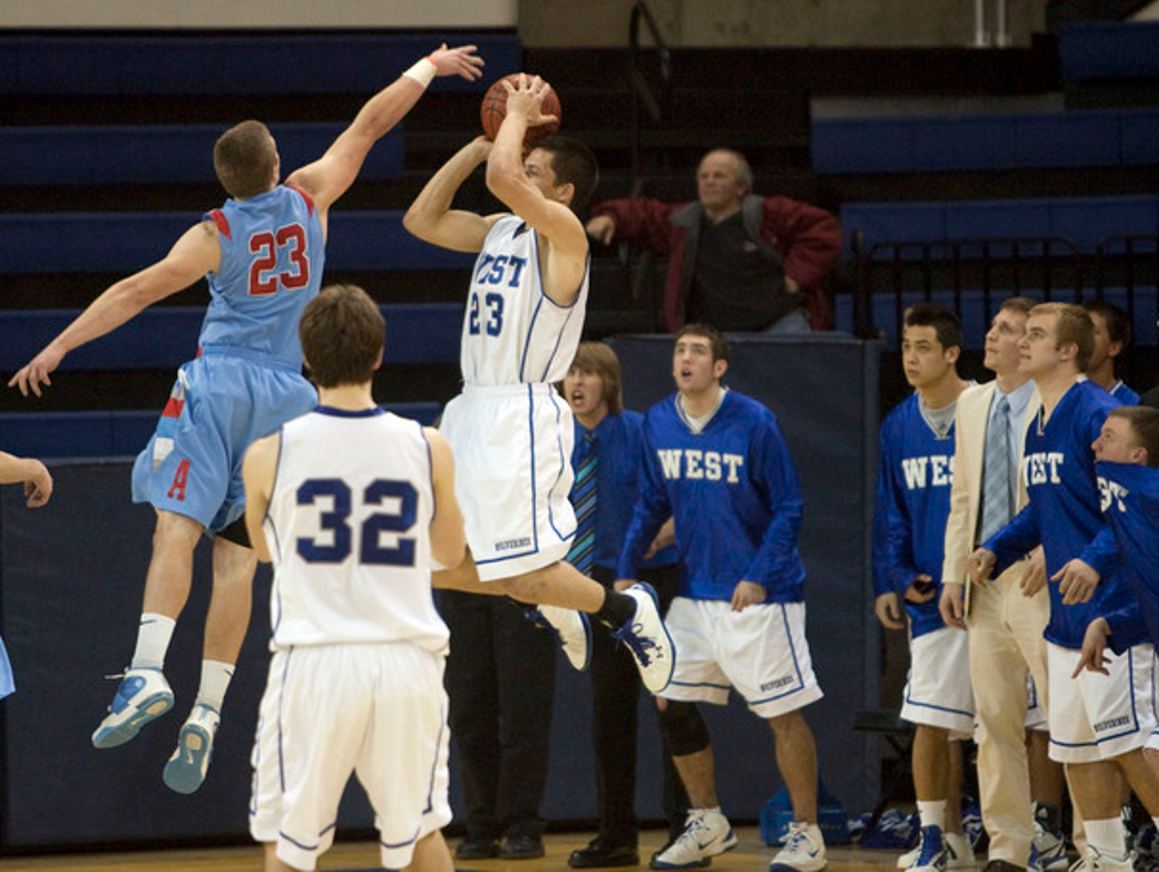 Waukesha West's Joe Schobert (23) leaps up for a last-second