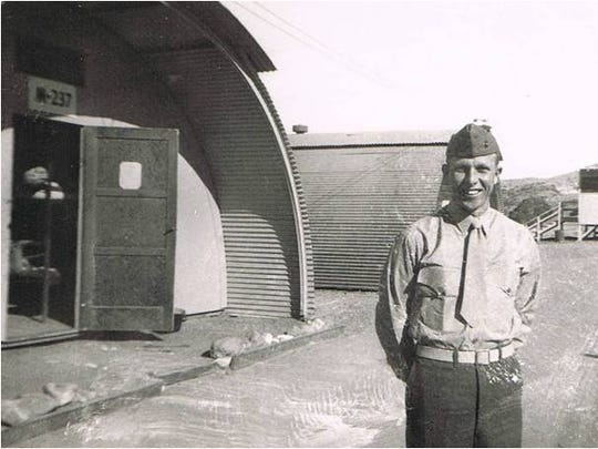 Bubba Brasher stands near a Quonset hut during his time in the Marines when he was a supply sergeant during World War II.