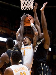 Tennessee guard Lamonte Turner (1) attempts a shot