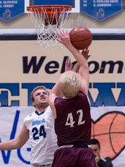 Redwood's Drew Stogsdill deflects the shot of Mt. Whitney's