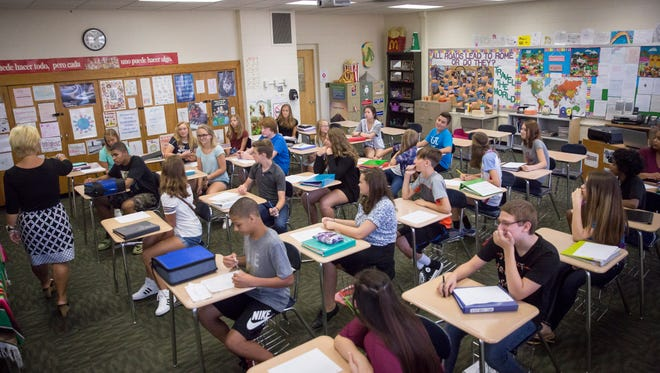 Yorktown Middle School students readjust to school life Friday morning during the first day back to school for the Yorktown Community School District.