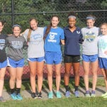Wyoming's girls cross country team takes in the sun before an evening race at Withrow Aug. 25. From left are junior Linda Kirsch, senior Emily Wood, junior Isabella Renggli, junior Terra Forsythe, senior Danielle McKee, senior Annie Spray and junior Whitley Elsass.