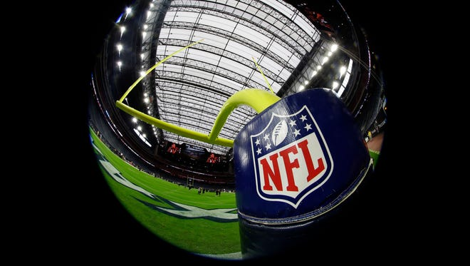 The NFL logo is seen on a goalpost pad before an NFL football game between the Houston Texans and the Baltimore Ravens.