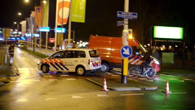 A police vehicle enters the Media Park in Hilversum, Netherlands, on Jan. 29, 2015, after a gunman entered the headquarters of Dutch national broadcaster NOS outside Amsterdam.