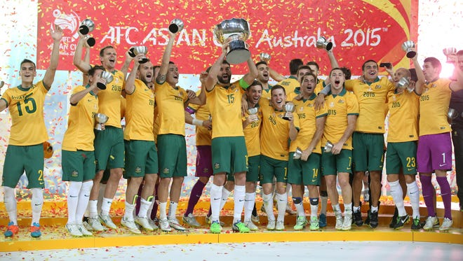 Australian players celebrate on the podium.