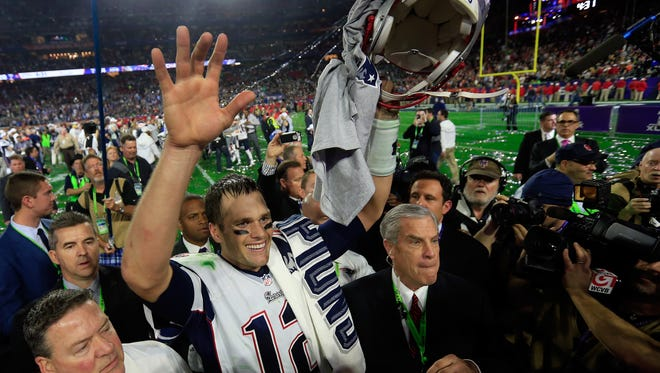 Tom Brady of the New England Patriots celebrates after defeating the Seattle Seahawks in Super Bowl XLIX at University of Phoenix Stadium.
