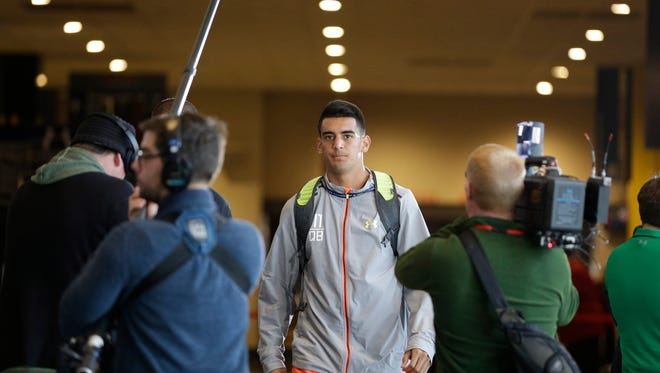 Oregon quarterback Marcus Mariota answers a question during a news conference at the NFL football scouting combine in Indianapolis, Thursday, Feb. 19, 2015.