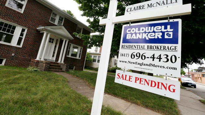 A sale pending sign is posted in front of a home in Quincy, Mass.