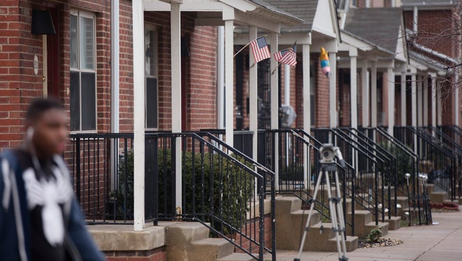 Flags are posted on the home of a woman who is accused of trying to join and martyr herself for the Islamic State group in Syria, Friday, April 3, 2015, in Philadelphia. Thirty-year-old Keonna Thomas appeared in federal court Friday afternoon just hours after her arrest on a charge of attempting to provide material support and resources to a foreign terrorist organization. A prosecutor says a search warrant executed March 27 at Thomas' home prevented her from leaving the U.S. on a flight scheduled for March 29.(AP Photo/Matt Rourke)