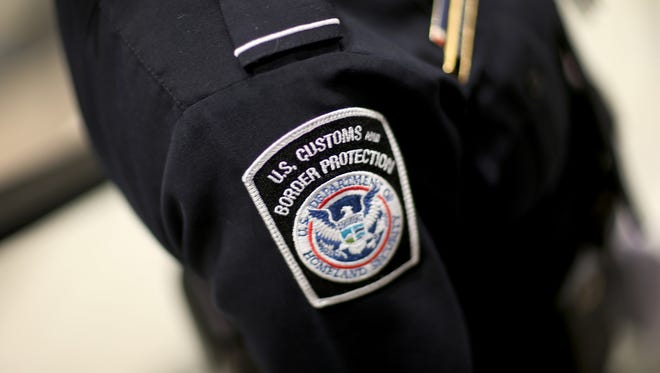 A U.S. Customs and Border Protection officer's patch is seen as they unveil a new mobile app for international travelers arriving at Miami International Airport on March 4, 2015.