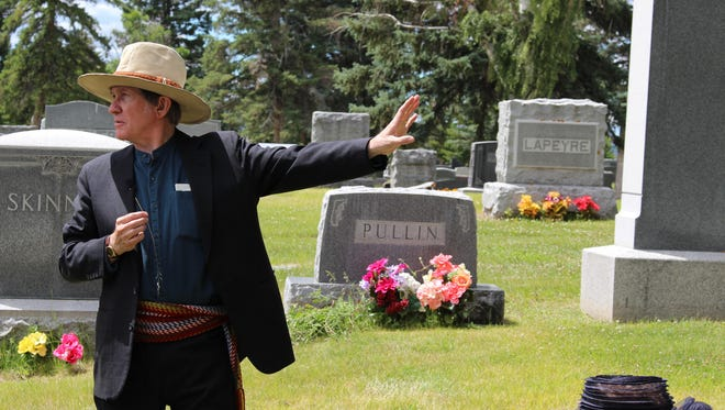 Bill Bronson plays Charlie Russell during the 2014 Waking the Dead tour at the Highland Cemetery outside Great Falls.