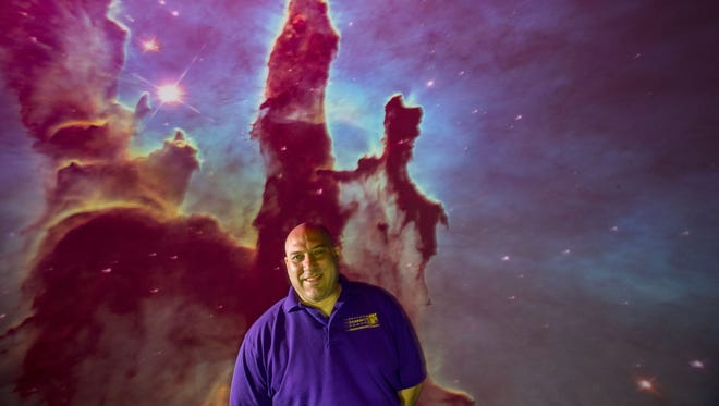 Mike George, Director of the Theaters, inside Dorrance Planetarium at the Arizona Science Center.
