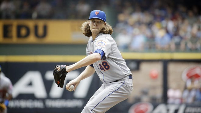 New York Mets starting pitcher Jacob deGrom throws during the first inning of a baseball game against the Milwaukee Brewers Thursday in Milwaukee.