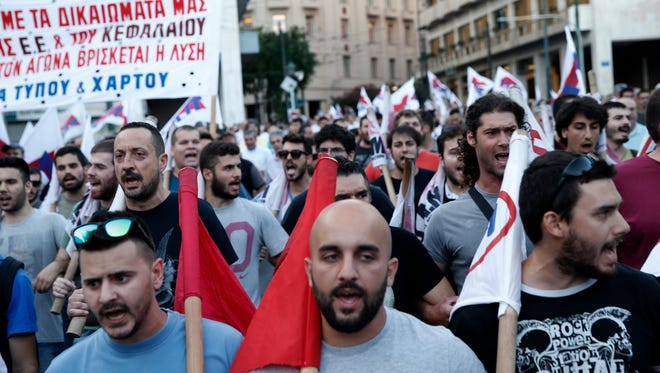 Members of a labor union shout slogans during an anti-austerity rally in Athens on July 15, 2015.