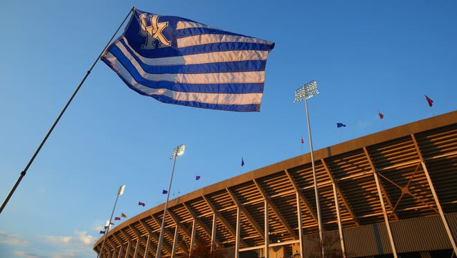 LEXINGTON, KY - OCTOBER 25:  A scenic photo of  a flag flying with Commonwealth Stadium on the campus of the University of Kentucky on October 25, 2013 in Lexington, Kentucky.