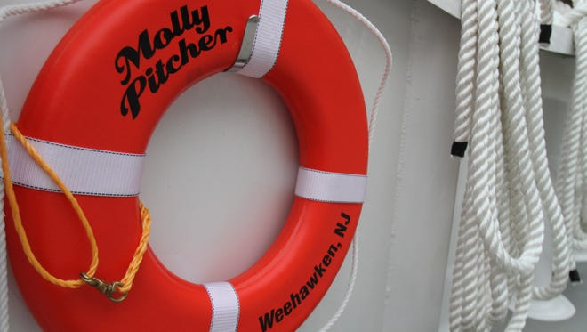 """A buoy hangs on the deck of the Molly Pitcher, the new """"luxury"""" commuter ferry from Middletown."""