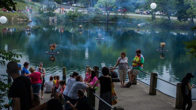 Crowds watch a pond fire in 2014 at Glen Miller Park.