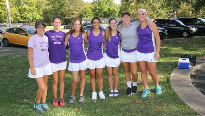 Members of the Lexington girls tennis team after it won the Ohio Cardinal Conference tournament. Sylvia Goldsmith (second from left) has qualified for state in singles, while Maya Ahmed (center) and Jordyn Traxler (second from right) have qualified in doubles.