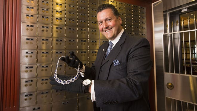 Alfredo Molina, Black, Starr & Frost chairman, displays the $4.5 million Empress necklace at Molina Fine Jewelers.