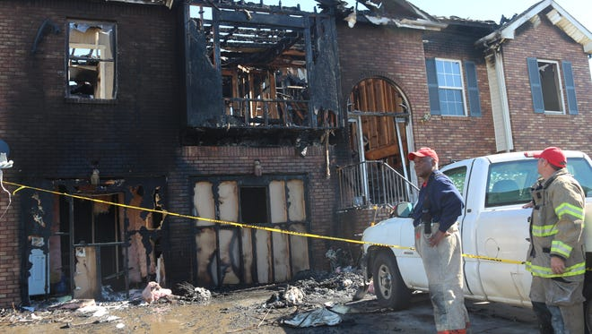 Clarksville Fire Marshal Ray Williams and Clarksville Fire Rescue Capt. Chuck Ladd look at a Harvest Ridge home that was destroyed by fire early Monday morning.