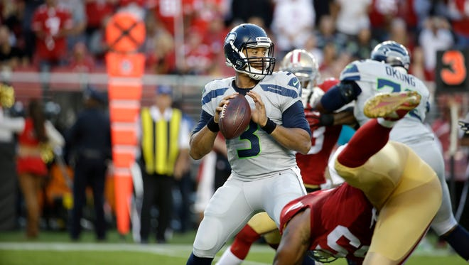 Seattle Seahawks quarterback Russell Wilson (3) passes against the San Francisco 49ers during the first half of an NFL football game in Santa Clara, Calif., Thursday, Oct. 22, 2015. (AP Photo/Marcio Jose Sanchez)