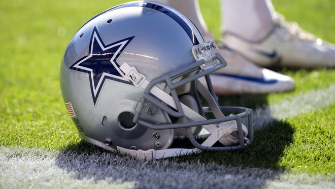 A Dallas Cowboys' helmet is seen before an NFL football game against the Philadelphia Eagles.