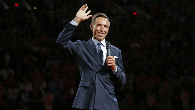 Former Phoenix Suns NBA All-Star point guard Steve Nash waves to the fans during his induction ceremony into the Suns Ring of Honor at halftime on Oct. 30, 2015 in Phoenix, Ariz. Nash becomes the 14th member of the Suns Ring of Honor at Talking Stick Resort Arena.