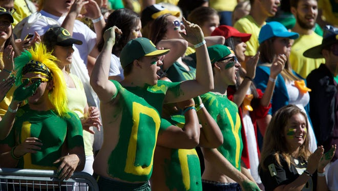 Sep 19, 2015; Eugene, OR, USA; Oregon Ducks fans celebrate a touchdown in the first quarter against the Georgia State Panthers at Autzen Stadium. Mandatory Credit: Scott Olmos-USA TODAY Sports
