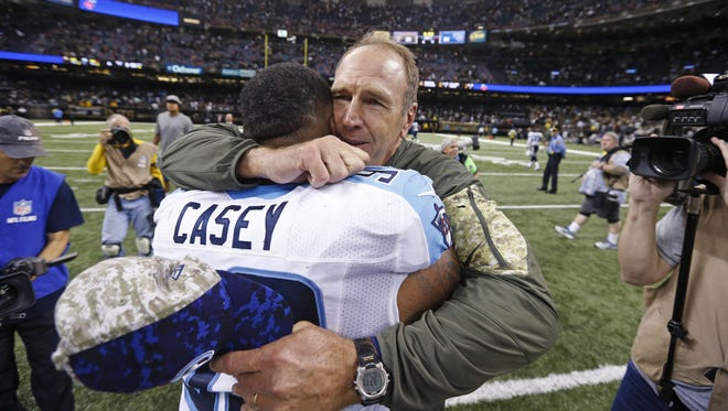 Tennessee Titans interim head coach Mike Mularkey hugs defensive end Jurrell Casey  after their overtime  victory over the New Orleans Saints.