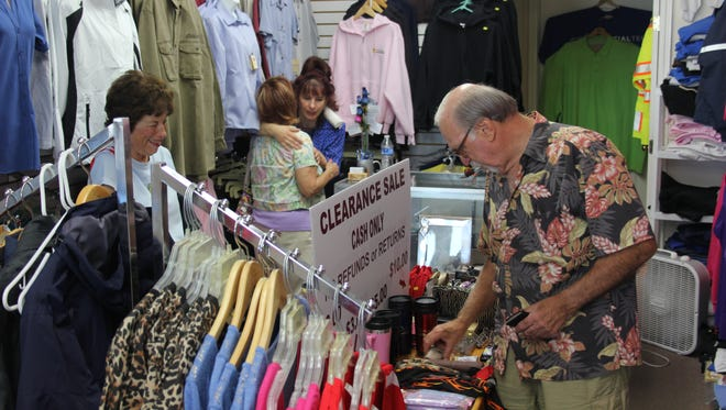 Customers, including Mesquite Mayor Al Litman, shop during a Cash Mob. The next Cash Mob is set to be 10 a.m., at Ready Golf & Gear Saturday.