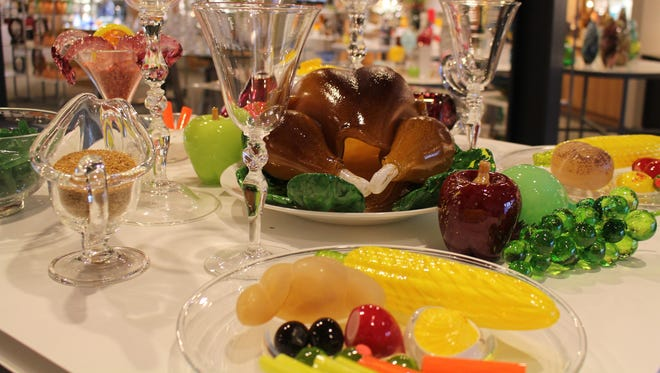 The glass holiday feast features meal staples like turkey, ham, mashed potatoes and green beans, all created by the Hot Glass Show team.