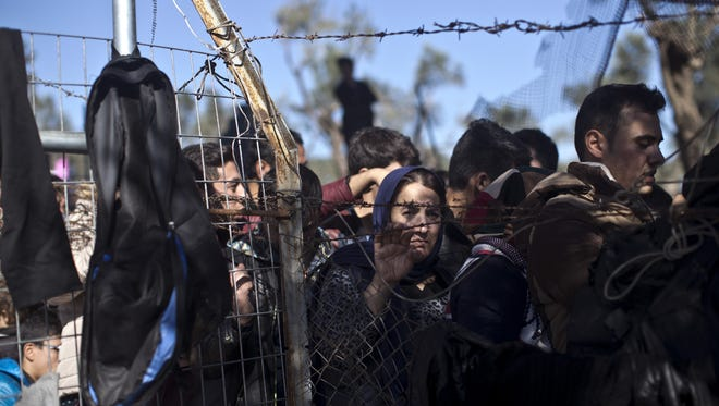 People wait Nov. 4 to enter the refugee registration camp on the island of Lesbos, Greece. The U.S. House voted recently to halt the admission of Syrian refugees.