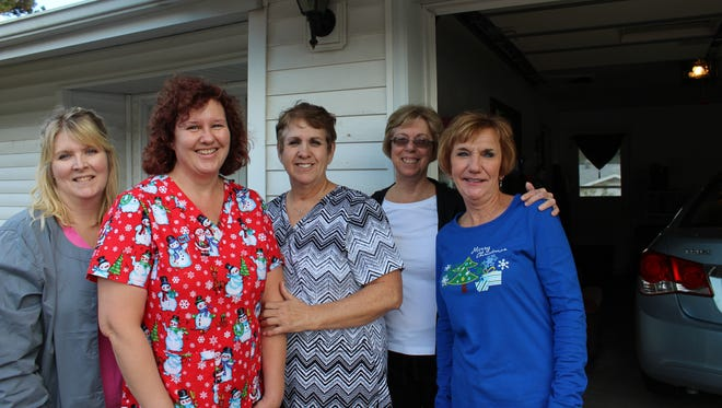 Caregivers and friends that helped Sherry McGoldrick celebrate her last Christmas include Tammy Moore, CNA; Christina Stone, nursing assistant; Aleta Newberry, BRMC Education Coordinator; Amy McGoldrick, Sherry's sister-in-law; and Cindy Davenport, a retired registered nurse.